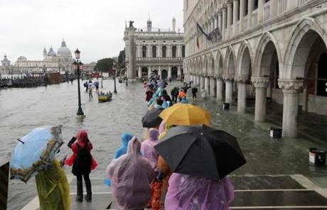 A catwalk was set up for tourists and others to avoid walking in the water during a high tide in Venice, Italy.