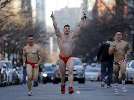 Participants run through the streets of the Back Bay during the 16th annual Santa Speedo Run in Boston, Massachusetts, December 12, 2015. Hundreds took part in the charity run to raise money for the Play Ball! Foundation. REUTERS/Brian Snyder