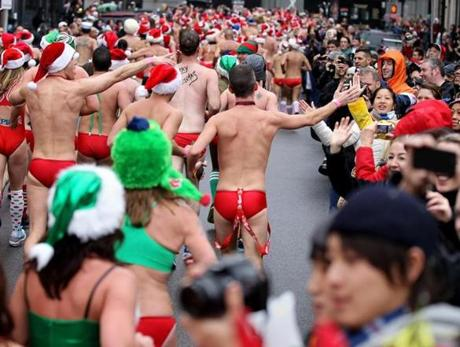 Boston, Massachusetts 12-08-2012 SSRun with runners dressed as Santa in Red Speedos head down Gloucester Street to finish on Boylston Street. The run benefits the Play Ball! Foundation. (Jonathan Wiggs ) Topic: Reporter: