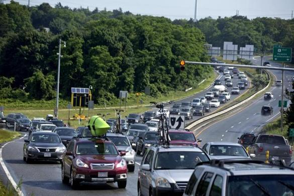 Traffic jams like this one near the Sagamore Bridge in July 2013 have boosted a proposal to use a public-private partnership to erect a third bridge across the Cape Cod Canal.