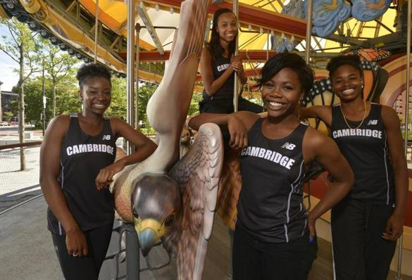 Kenlee Presume, right, led Cambridge to a track championship this season, along with Jordan Poindexter, Sydney Fisher, and Brianna Duncan, left to right.