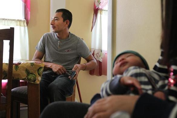 Moises Herrera said he was nearly deported and was kept in jail for weeks, missing the birth of his son.