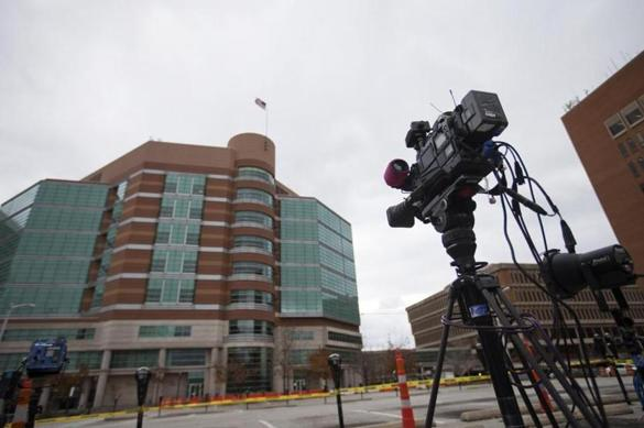 A television news camera points toward the building where the grand jury convened Monday on the Ferguson case.