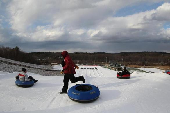 Tubers prepare for a ride at the New England Sports Park, which opened this month, a year after the previous owners filed for bankruptcy.