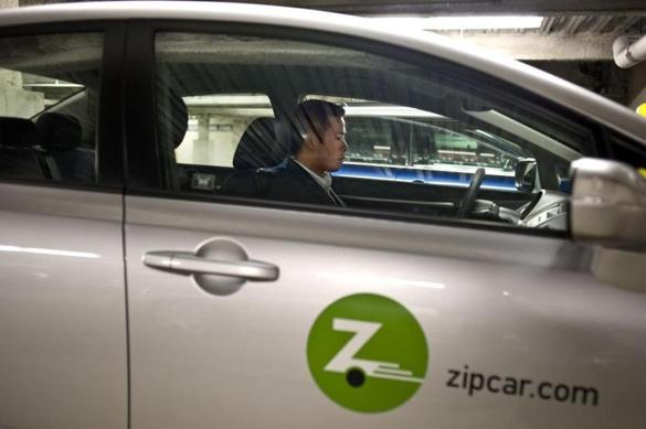Boston, MA, 05/04/09 - Tim Inthirakoth cq, picks up a hybrid zipcar from James Court garage in the South End on Monday, May. 04, 2008. (Photo / Wiqan Ang) Desk: Business Category: Section front Reporter: Clifford Atiyeh 203-415-7723. Editor: Mark Pothier Library Tag 09232009