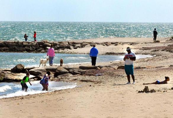 Beach-goers enjoyed the shore in Falmouth earlier this month.
