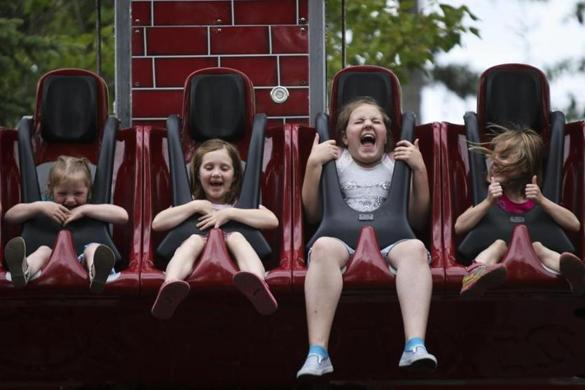 Young park-goers showed their enthusiasm on a ride at the Jefferson, N.H., amusement park.
