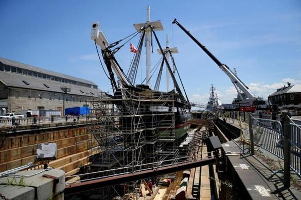 "The USS Constitution, the oldest commissioned ship afloat in the Navy — it was launched in 1797 and earned its nickname ""Old Ironsides"" in the War of 1812 — is in the midst of a three-year restoration at Dry Dock 1 at the Charlestown Navy Yard."