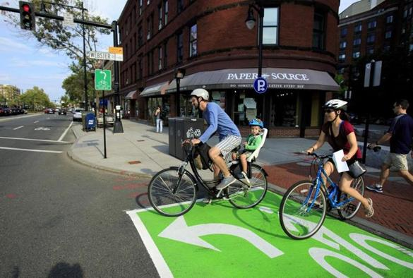 "A ""bike box"" was recently painted at the intersection of Beacon, Webster and Centre streets in Brookline, giving cyclists a head start atthe traffic lights."