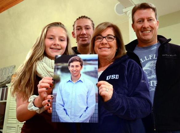 Hingham 11/02/2015: University of San Diego freshman Tom Noonan's family: (l-R) Meredith Noonan, 15, Jack, 18, mother Mal and father Phil with a picture of Tom. Photo by Debee Tlumacki for the Boston Globe (regional)