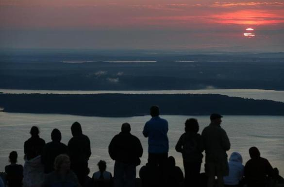 Visitors watched the sun rise from atop Cadillac Mountain in Acadia National Park. Maine locations have become official names for several places on Mars.