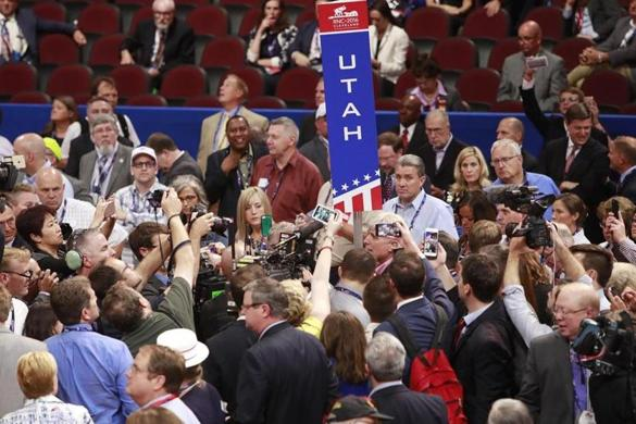 epa05431073 The Utah delegation chair calls for a roll call vote during the first day of the 2016 Republican National Convention at Quicken Loans Arena in Cleveland, Ohio, USA, 18 July 2016. The four-day convention is expected to end with Donald Trump formally accepting the nomination of the Republican Party as their presidential candidate in the 2016 election. EPA/DAVID MAXWELL