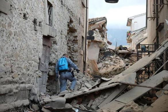 A rescuer roamed through the rubble in Amatrice, Italy, in search of victims.