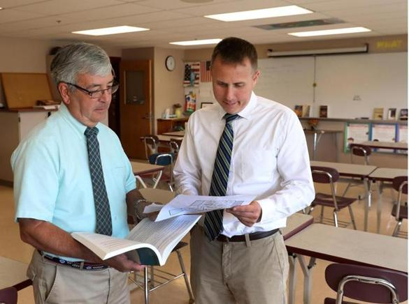 Mattapoisett , MA - 9/06/2016: L-R Frank Calore, 69, of Wareham, a retired teacher with 40 years experience in the Acton-Boxborough School District, is considered the gold standard. He is with Michael Devoll, Principal of Old Rochester Regional High School in Mattapoisett (David L Ryan/Globe Staff Photo) SECTION: REGIONAL TOPIC xxsosubstitute