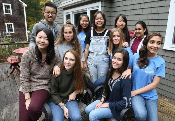 Marshfield,MA 10/22/16 International students gather at a host home for orientation, all here attending public schools in southeastern Mass. the eleven students gather on the back porch for a group photo.... (George Rizer for the Globe)