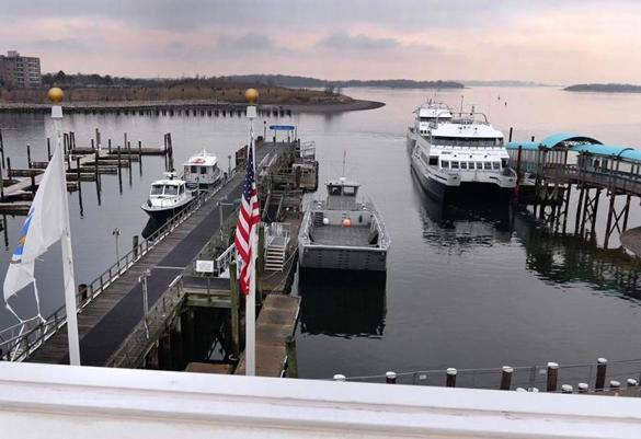Hingham 12/07/2016 : The view from the roof of the Hingham Intermodel Center that overlooks the waterfront . It is a 8,400-square foot, two story modern transportation facility located at the Hingham Shipyard. The goal of the new facility is to allow passengers to move seamlessly between the Commuter boats, the ferries to the Harbor Islands and the MBTA bus. Photo by Debee Tlumacki for the Boston Globe (south)