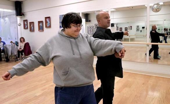 01-11-2017: Salisbury, MA: Megan DiPietro dances with instructor Cris Plumley at the Footloose Dance Studio in Salisbury, Mass. in a Shared Living Collaborative program January 11, 2017. Photo/John Blanding, Boston Globe staff story/James Sullivan, NOWK ( 29noshared )