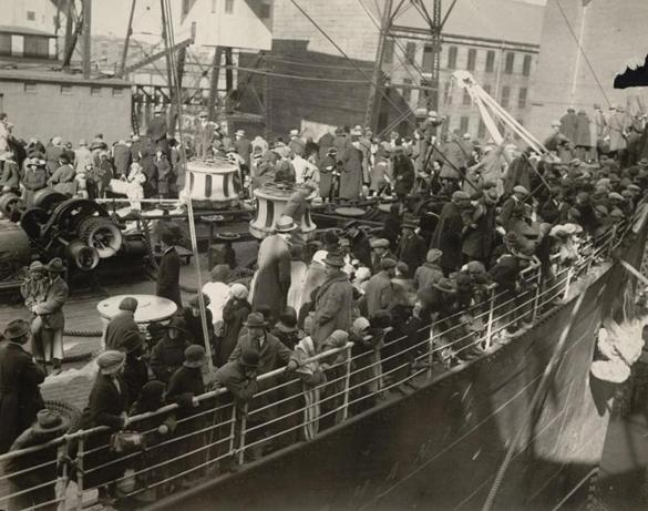S.S. Carmania arriving with immigrants from Eastern Europe in 1923, docking at East Boston immigration station.