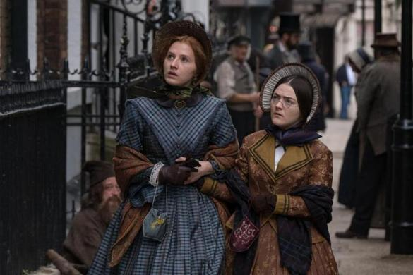 "Charlie Murphy (left) as Anne Bronte and Finn Atkins as Charlotte Bronte in ""To Walk Invisible: The Bronte Sisters."""