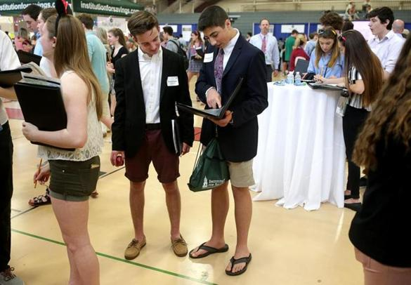 Boxford Ma 04/11/2017 Masconomet students Timothy Puglisi (cq) left and Benjamin Dindo (cq) right were part of several hundred high school students who took part in a Credit for Life Fair at Masconomet Regional High School. Students have to learn how to manage a house whole budget, that includes housing,transportation,credit card limits and other economic considerations. Jonathan Wiggs /GlobeStaff) Reporter:Topic