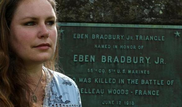 Bethany Groff Dorau, a local historian, at the site honoring Eben Bradbury Jr. Triangle, located at Bartlett Mall in Newburyport. The plaque honors the first local resident to die in the Great War in the Battle of Belleau Wood. Mark Lorenz for the Boston Globe.