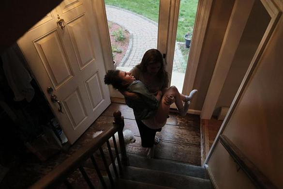 Dracut, Ma., 06/08/17, It's been over 100 days since Noelia has had skilled nursing help. She carries her 78-pound daughter up the stairs to begin the evening's bed-time rituals. Suzanne Kreiter/Globe Staff