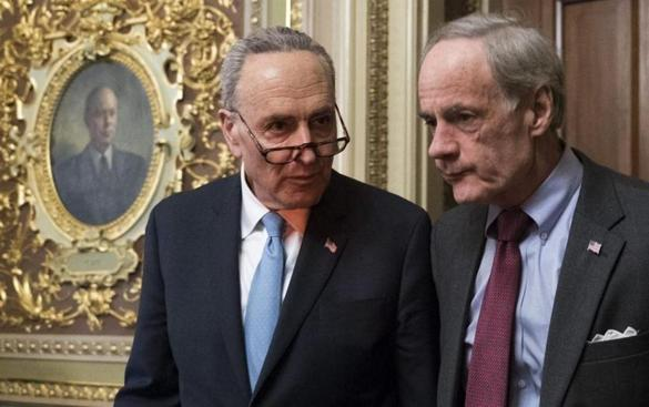 Mandatory Credit: Photo by SHAWN THEW/EPA-EFE/REX/Shutterstock (9326629bh) Chuck Schumer and Tom Carper Negotiations continue in the House and Senate to avert a government shutdown, Washington, USA - 19 Jan 2018 Senate Minority Leader Chuck Schumer (L) and US Democratic Senator from Delaware Tom Carper (R) walk out of a meeting of the Democratic senators in the US Capitol in Washington, DC, USA, 19 January 2018. Negotiations continue in the Senate to avert a government shutdown.