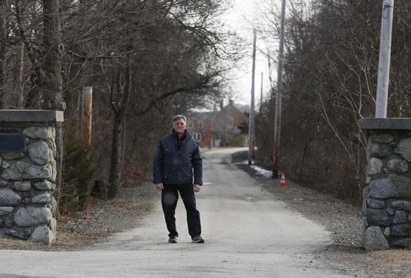 Rowley, MA -- 2/06/2018 - Michael Sabatini, owner of the Barn at Bradstreet Farm, poses for a photo on the driveway leading to his property. Sabatini has faced municipal roadblocks, including a cease and desist order while trying to open an event venue. The town had cited emergency vehicle access through the stone pillars as a safety concern. (Jessica Rinaldi/Globe Staff) Topic: 18norowley Reporter: