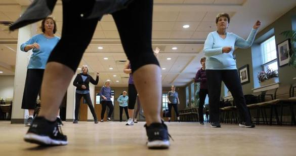 "Instructor Cassandra Hunt, foreground, leads a ""Zumba Gold"" class at  the Sharon Adult Center."