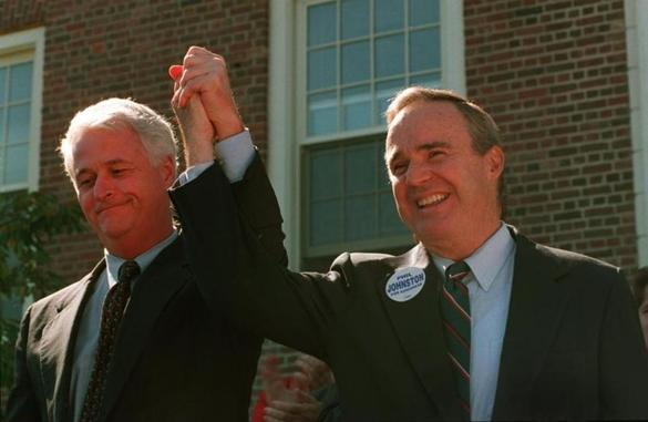 William Delahunt (left) and Philip Johnston joined hands in front of Weymouth Town Hall during a press conference in 1996.