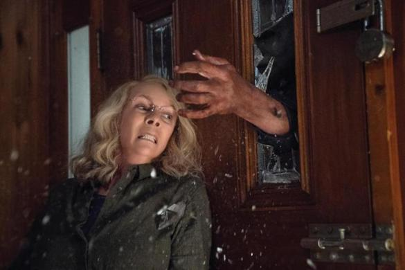 Laurie Strode (Jamie Lee Curtis) barricades herself inside her home (to no avail) in