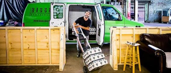 Josh Schlesinger, owner of Sleek Machine Distro, loads a van with Bissell Brothers beer.