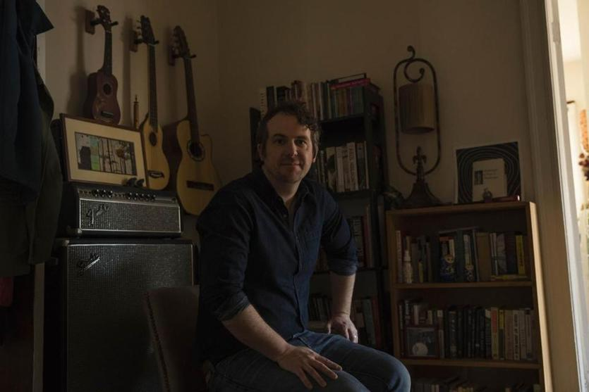 "Ryan Walsh, who has written the book ""Astral Weeks: A Secret History of 1968,"" at his home in Jamaica Plain."