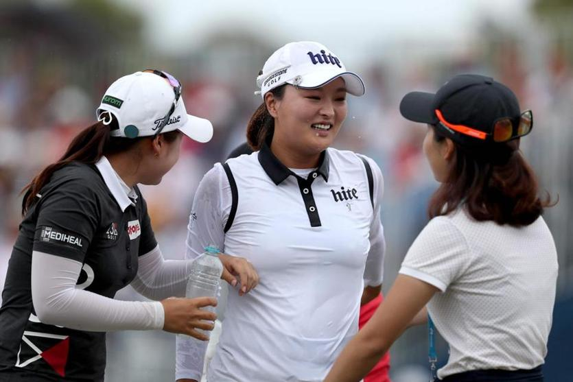 Jin Young Ko (center) celebrates her Women's Australian Open victory in Adelaide.