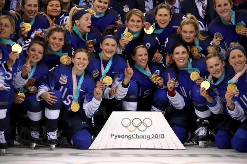 Proudly showing their new gold medals.