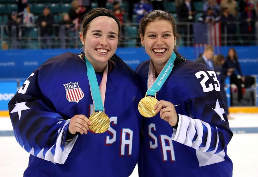 Rooney (left) and Sidney Morin — former teammates at Minnesota Duluth — show off their new hardware