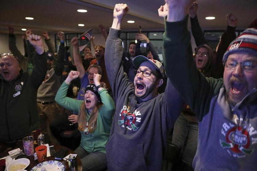 Curling fans at the Frogtown Curling Club in St. Paul, Minn., erupt with joy after watching the US men's team win Olympic gold over Sweden, 10-7.