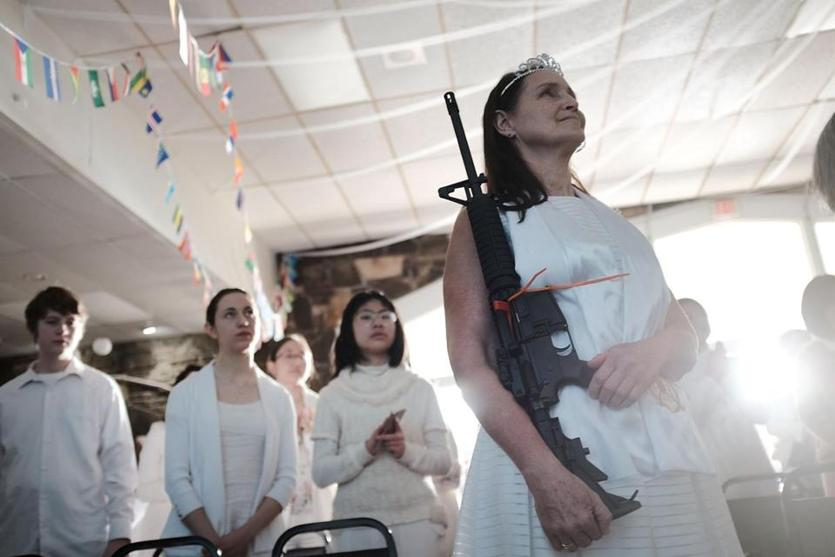 "A woman participated. The controversial church, which is led by the son of the late Rev. Sun Myung Moon, believes the AR-15 symbolizes the ""rod of iron"" in the biblical book of Revelation, and it encouraged couples to bring the weapons to a ""commitment ceremony."""