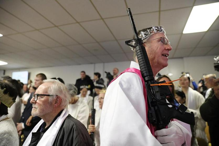 A church offical held an AR-15.
