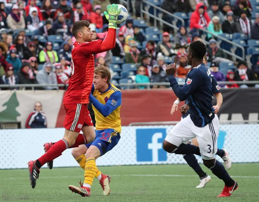 Revolution goalie Matt Turner makes a save in front of teammate Jalil Anibaba and the Rapids' Jack McBean.