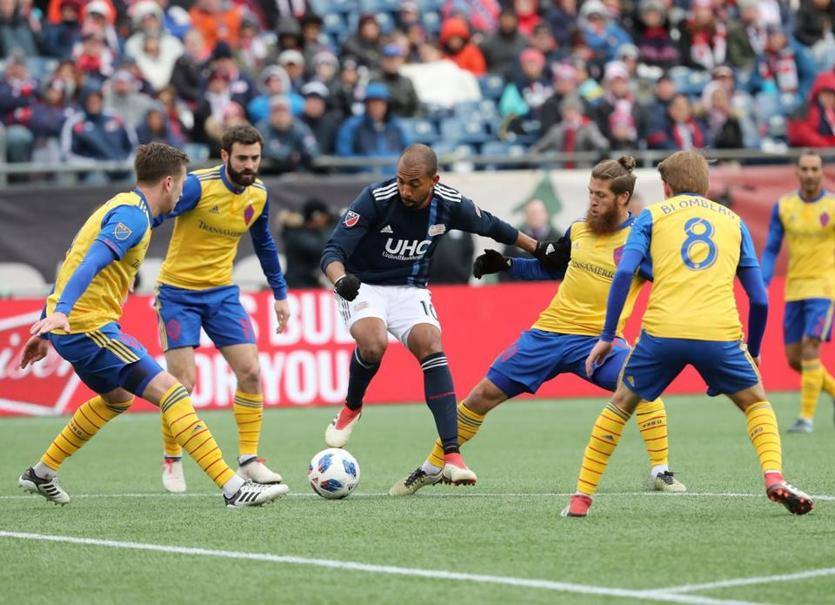 Teal Bunbury contols the ball with pressure from the Colorado Rapids defense during second half action.