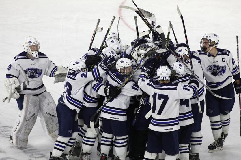 Lowell, MA - 3/11/18 - Swampscott piles up to celebrate their win. Swampscott defeats Wayland in the boys' Division 3 North 2018 MIAA Hockey Tournament (cq). Photo by Pat Greenhouse/Globe Staff Topic: 12schbhockey Reporter: Bob Holmes