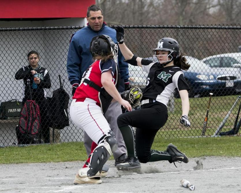 Bridgewater-Raynham catcher Alexis Silva puts the tag on Marshfield's Liz Viola as she attempts to score.