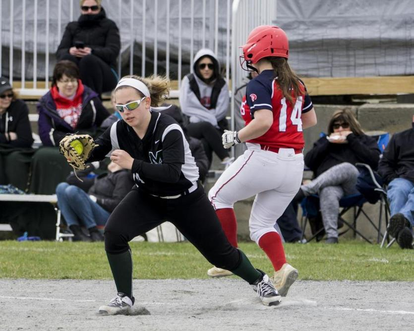 Marshfield first baseman Lilli McNeice squeezes the ball in her glove before Bridgewater-Raynham catcher Alexis Silva can get to first base.
