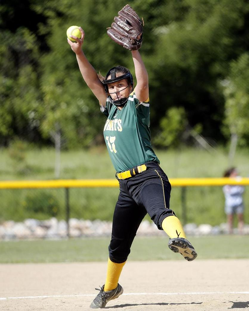 North Reading pitcher Christina Simblaris winds up to deliver.