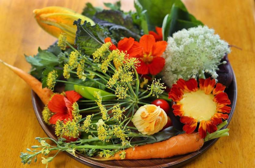 "A crudite platter of farm vegetables and flowers with ""aioli that tastes like sunshine."""