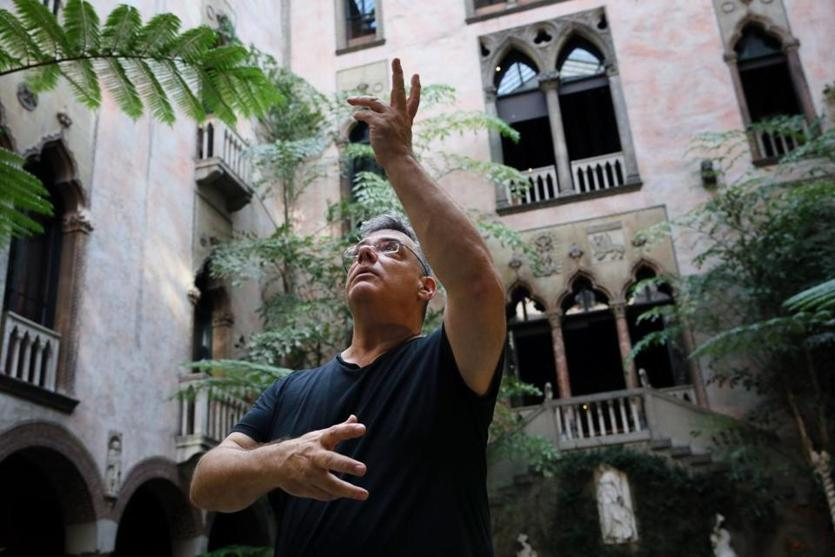 Choreographer Peter DiMuro, in the Gardner Museum's courtyard, directs the dancers.