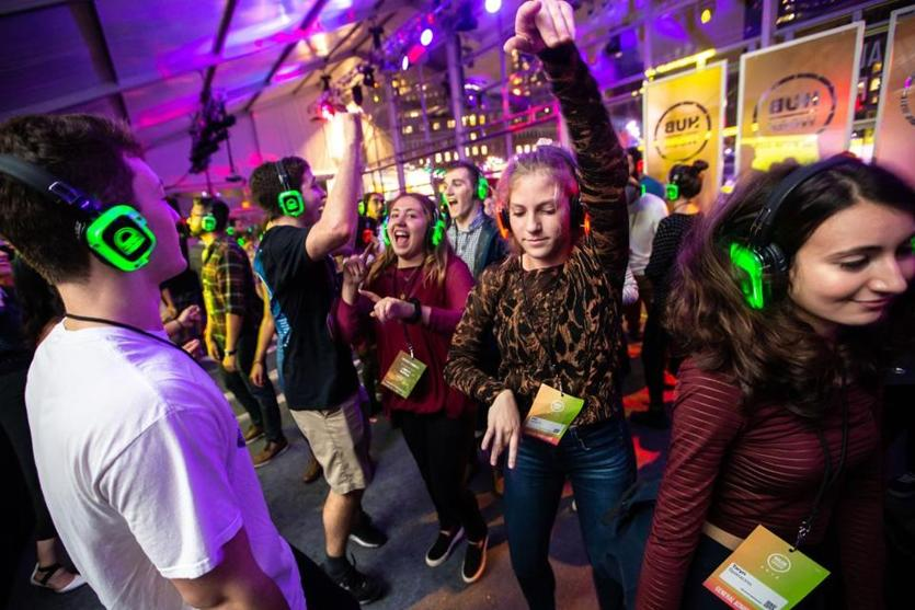 Mia Wallach (center) danced as participants listened to music on wireless headphones during the Silent Disco held at HUBweek in Boston.