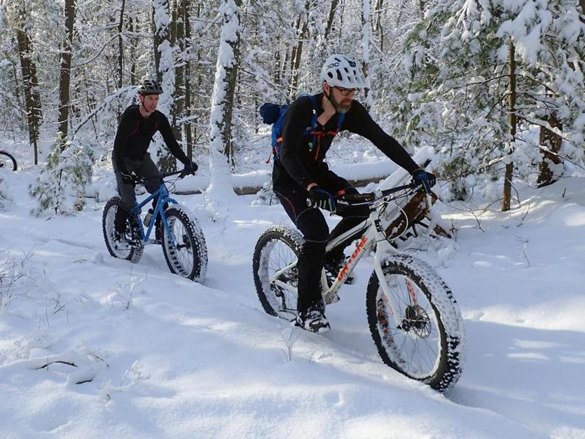 06zoexercise - ***ONE-TIME PRINT USE - NO ONLINE USE *** - Merrimack Valley NEMBA members (from right) Steve Richardson and Kirk Goldsworthy enjoy the snow-covered trails of the Russell Mill Town Forest in Chelmsford aboard their fat bikes. (New England Mountain Bike Association)
