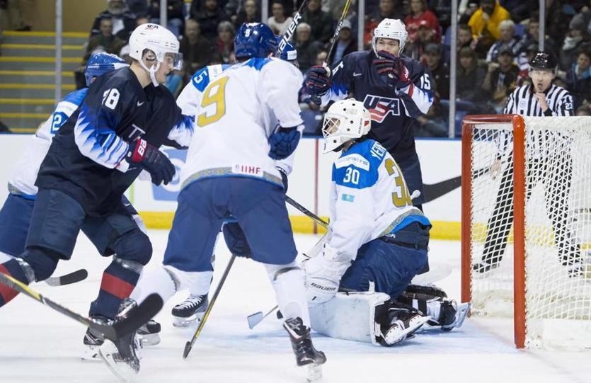 Joel Farabee (No. 28) puts a shot past Kazakhstan goaltender Demid Yeremeyev during the first period of a world junior hockey championships game.